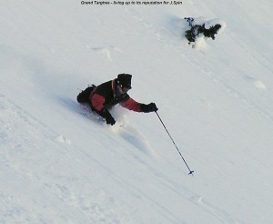 A picture of Jay skiing powder below Peaked Mountain Grand Targhee Resort Wyoming