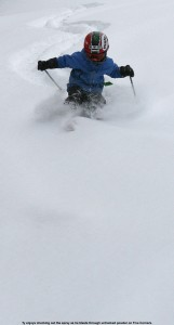Image of Ty skiing powder on Five Corners