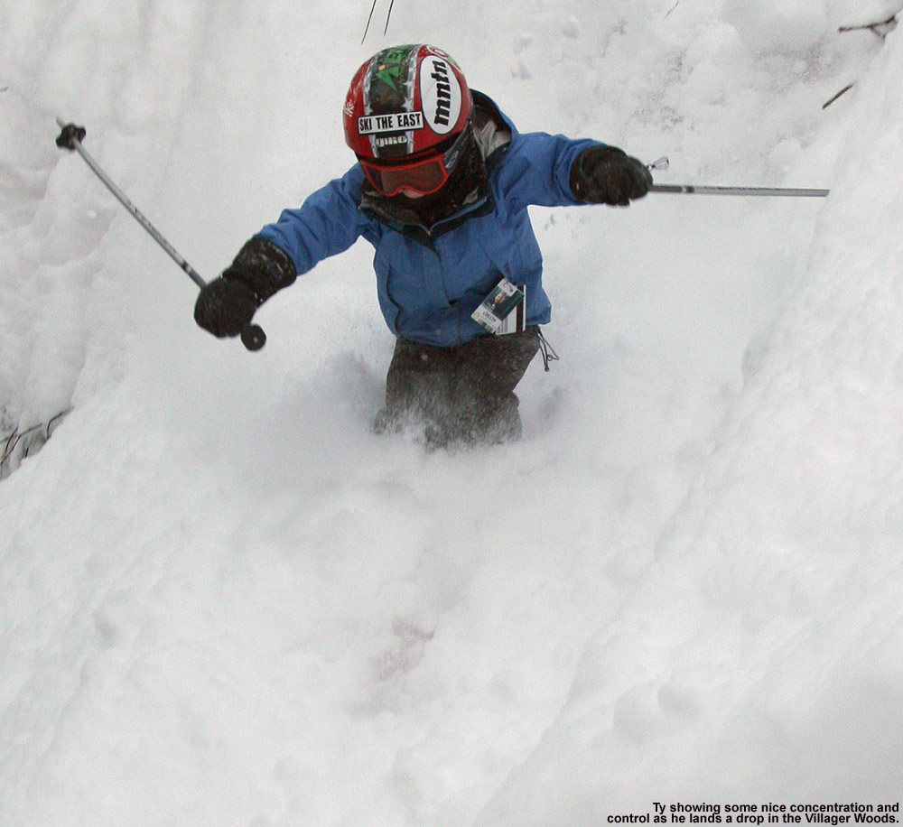 An image of Ty dropping into powder off a cliff in the Villager Trees at Bolton Valley Ski Resort in Vermont