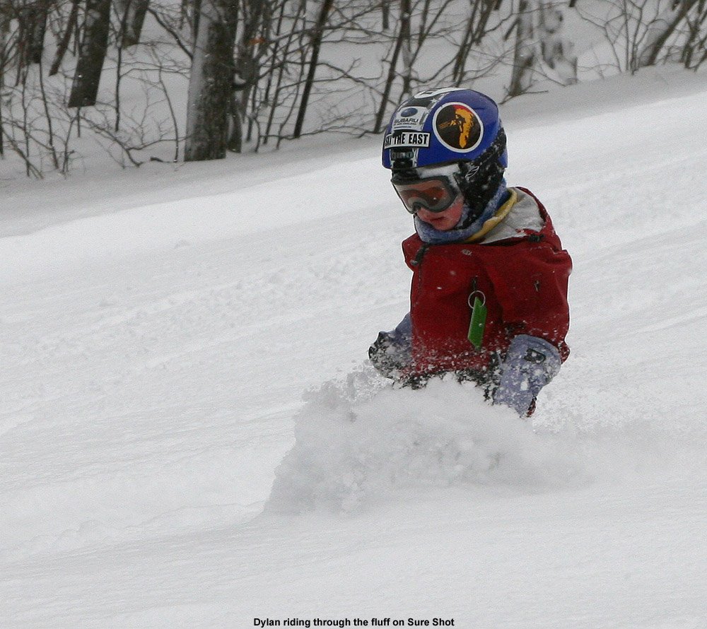An image of three-year old Dylan skiing the powder on the Sure Shot trail at Bolton Valley Ski Resort in Vermont