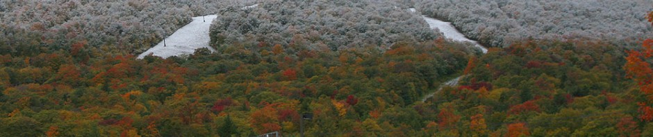 An image of Mt. Mansfield at Stowe Vermont with fall foliage and October snow in the higher elevations