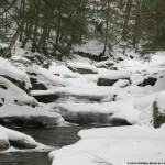 An image of Ridley Brook in winter along Camel's Hump Road in Waterbury/Duxbury Vermont