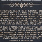 An image of the plaque commemorating the crash of an airplane on Camel's Hump in Vermont