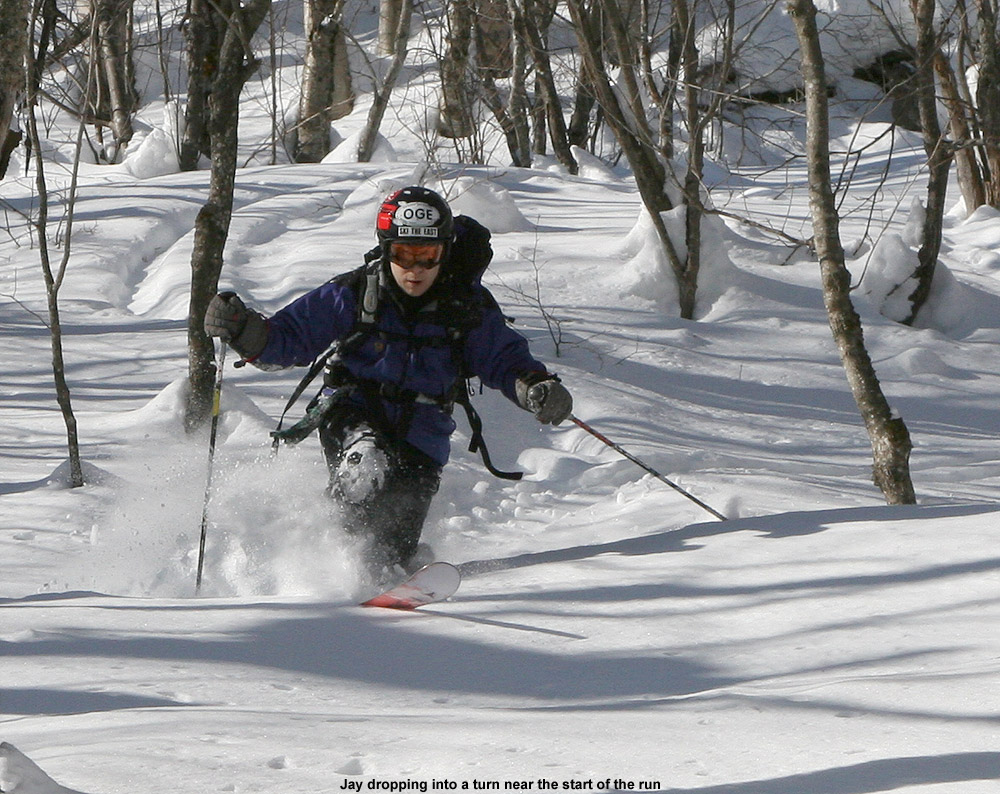 An image of Jay Telemark skiing in powder snow on Bald Hill near Camel's Hump in Vermont