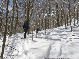 An image of Ty and James ascending Bald Hill on their skis near Camel's Hump in Vermont