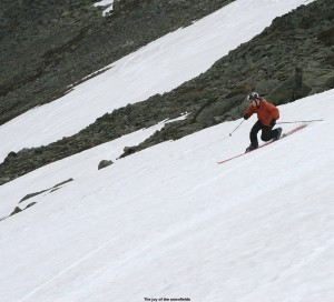 An image of Jay Telemark skiing on the Snowfields of Mt. Washington in New Hampshire on Memorial Day weekend 2010