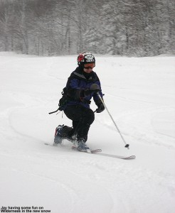 Image of Jay Telemark skiing in new snow