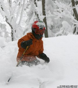 An image of Ty skiing powder in the trees off Wizard Way at Bolton Valley Resort in Vermont