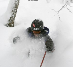 An image of Jay about to take a face shot skiing deep powder at Bolton Valley, Vermont