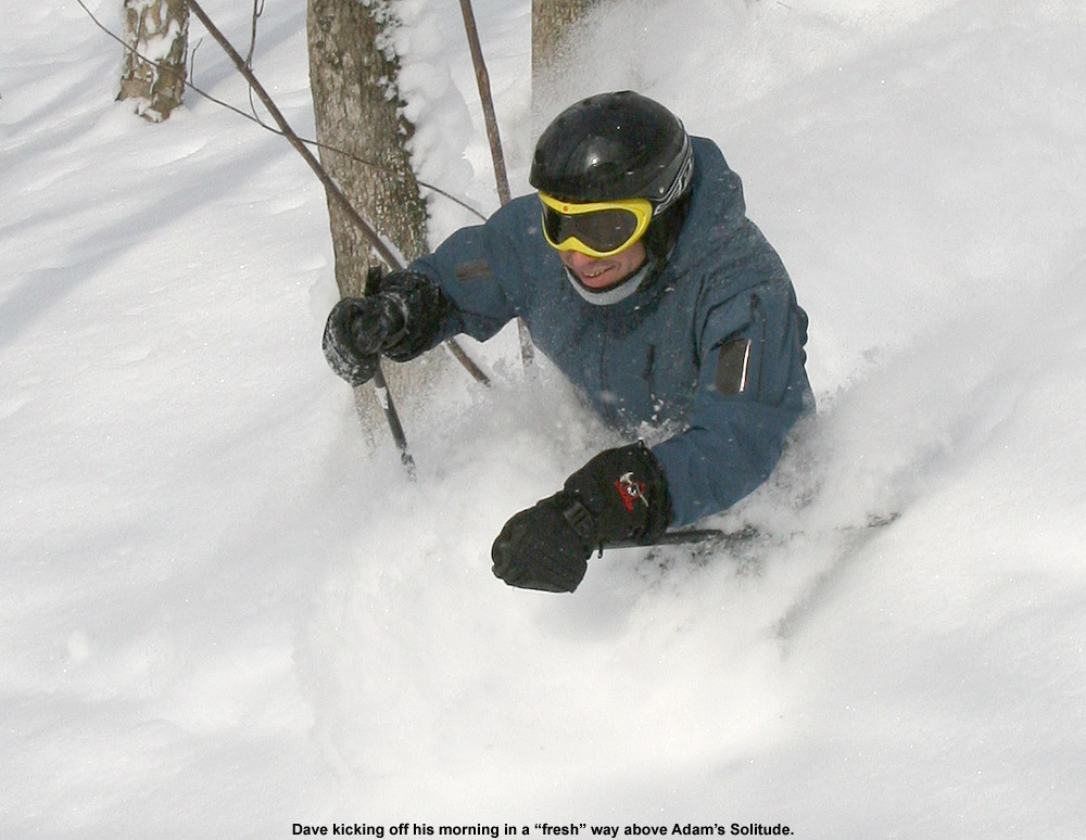 An image of Dave waist deep in the powder in the Adam's Solitude area at Bolton Valley, Vermont