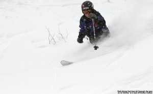 An image of Jay Telemark skiing in the Powder off the side of Bolton Outlaw at Bolton Valley Resort in Vermont