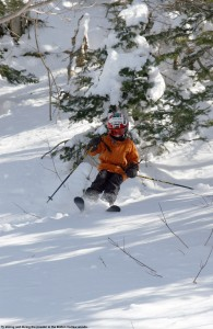 A picture of Ty skiing powder in the trees around Bolton Outlaw