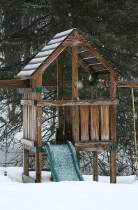 Snowfall and new snow on the playset out back
