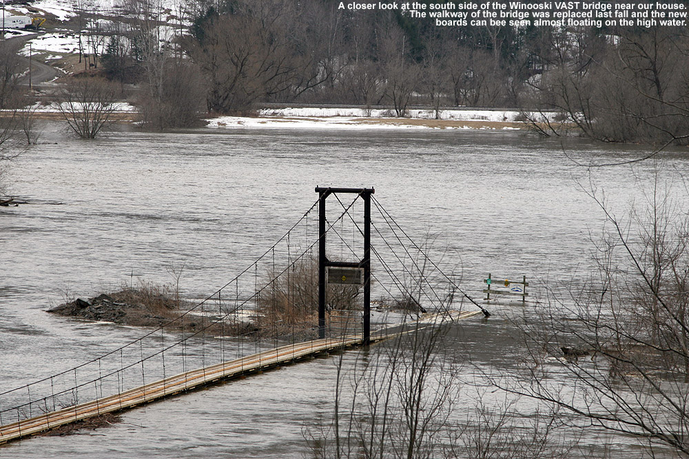 Close up image of the VAST snowmobile bridge at high water