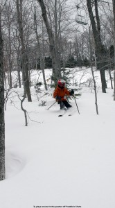 Image of Ty skiing in the trees at Stowe