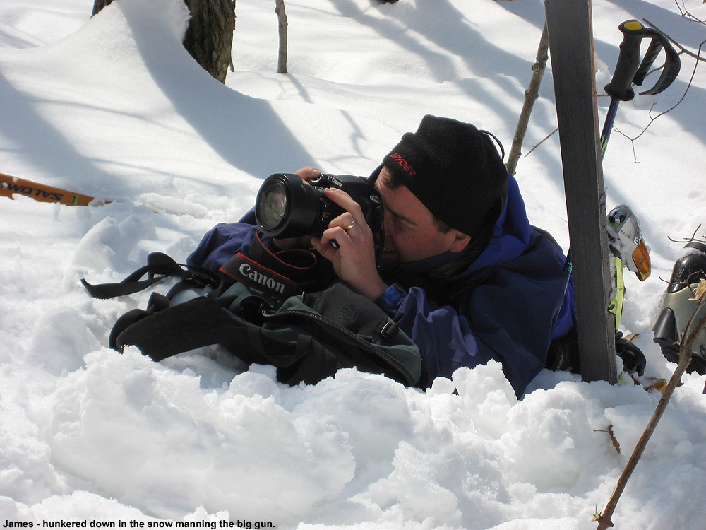 An image of James shooting photos with a Canon EOS 30D on a backcountry ski trip to Pease Mountain in Vermont