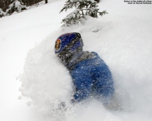 Image of Dylan getting a face shot in deep powder
