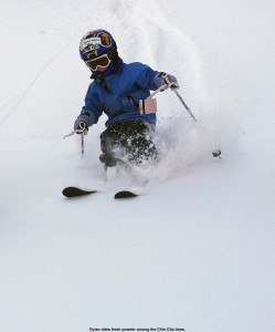 An image of Dylan skiing in powder
