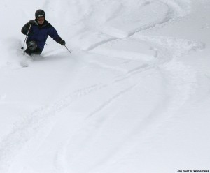 An image of Jay skiing powder