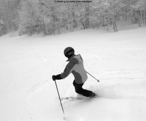 An image of Erica skiing powder