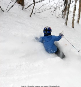 Image of Dylan skiing powder at Stowe