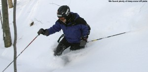 An image of Jay skiing the glades