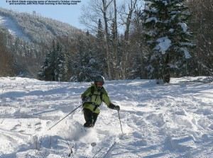An image of Erica skiing powder on the Birch Glades Trail at Pico Vermont - October 30, 2011