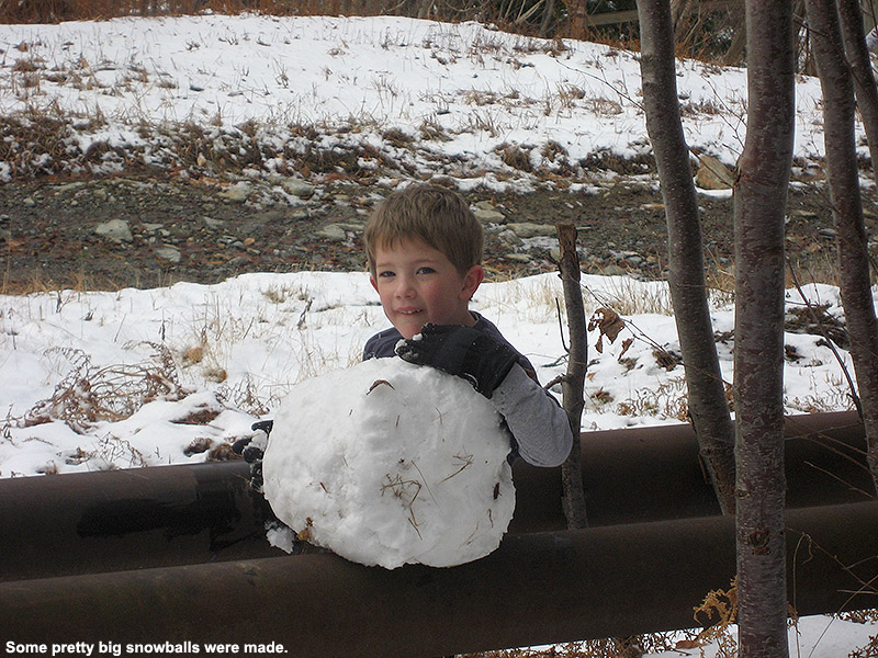 An image of Dylan with a November snowball up at Bolton Valley Resort in Vermont