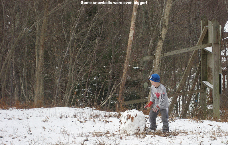 An image of Ty rolling a snowball at Bolton Valley Resort in Vermont after a November snowfall