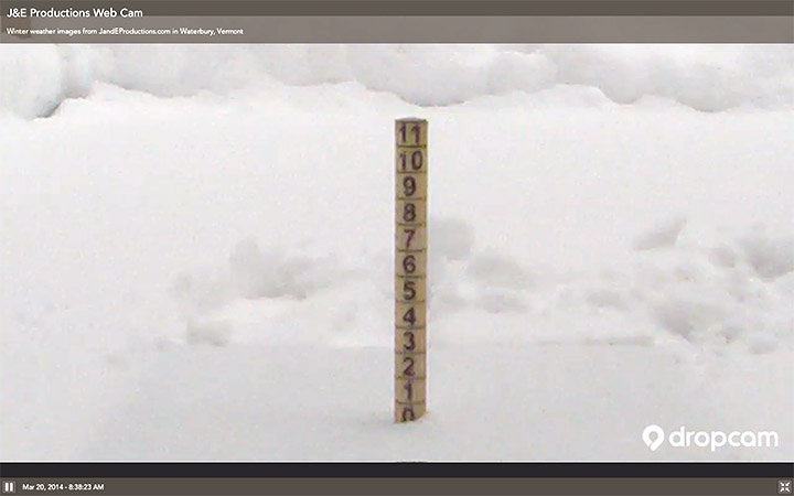 An image taken by the J&E Productions web camera showing a touch of snow at our measurement stake on the back deck of our house in Waterbury, Vermont