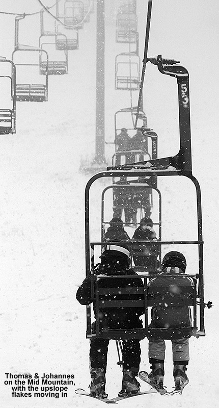 An image of the Mid Mountain Chairlift at Bolton Valley with snow falling on December 23, 2011
