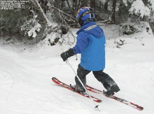 An image of Dylan Telemark skiing along the side of Bear Run at Bolton Valley Resort in Vermont