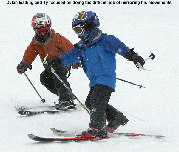 An image of Ty and Dylan attempting synchronous Telemark turns on Bear Run at Bolton Valley Resort in Vermont