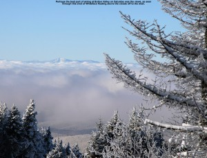 A westward view of Whiteface Mountain above the clouds from Bolton Valley Resort in Vermont