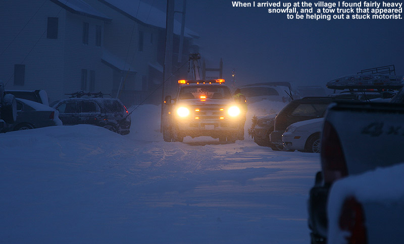An image of a tow truck helping a stuck car int he Bolton Valley village during heavy snowfall from a storm on Decmeber 28, 2011