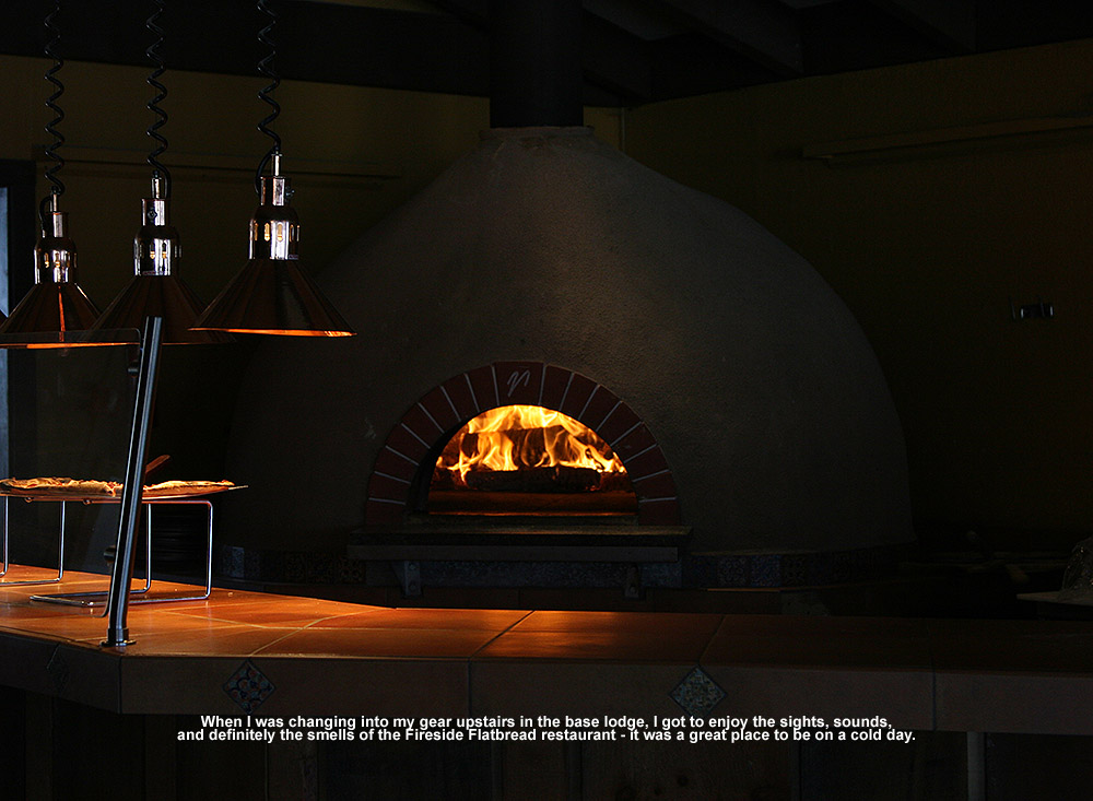 An image of flames in the wood-fired oven up at the Fireside Flatbread Restarant at Bolton Valley ski resort in Vermont