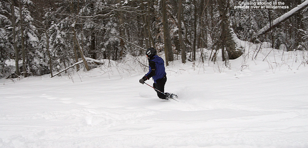 An image ofAn image of Jay skiing powder on the Lower Turnpike trail at Bolton Valley Ski Resort in Vermont