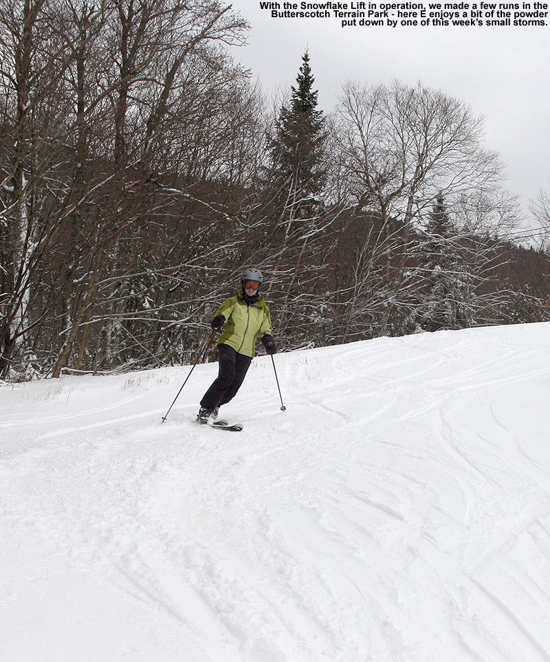 An image of Erica skiing a couple inches of fresh powder along the edge of the Butterscotch Terrain Park at Bolton Valley Resort in Vermont