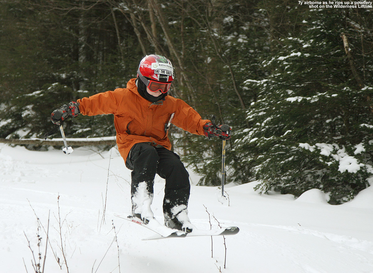 An image of Ty catching air amidst the powder on the Wilderness Lift Line at Bolton Valley Ski Resort in Vermont