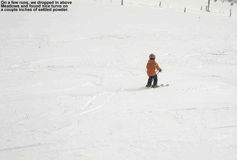 An image of Ty skiing above the Meadows area at Stowe Mountain Resort in Vermont