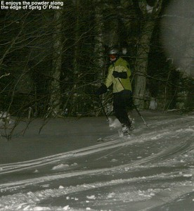 An image of E skiing fresh powder at night on the Sprig O' Pine trail at Bolton Valley Resort in Vermont