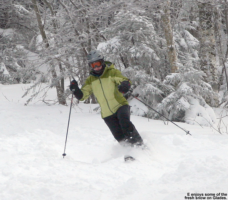 An image of Erica in a Telemark turn in the fresh snow at Bolton Valley Ski Resort in Vermont