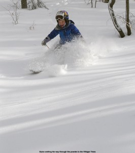 An image of Dylan skiing powder in the Villager Trees at Bolton Valley Resort in Vermont