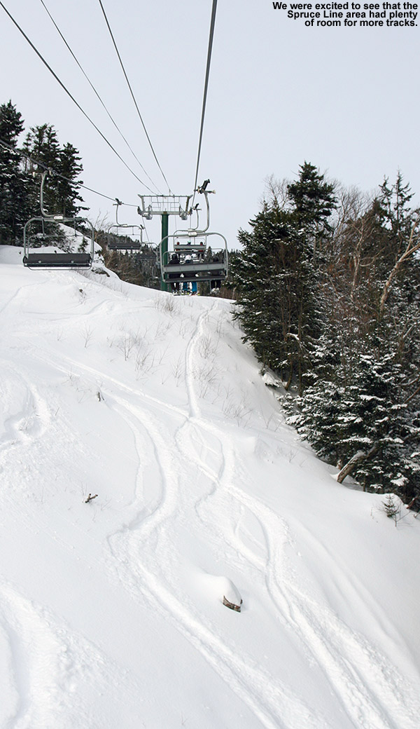 An image of ski tracks in powder snow on the Spruce Line Trail at Stowe Mountain Resort in Vermont