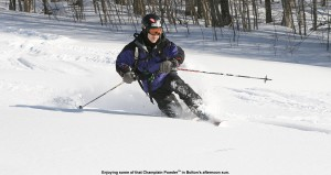 An image of Jay Telemark skiing in the powder on Spell Binder at Bolton Valley Ski Resort in Vermont
