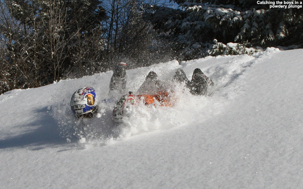 An image of Ty and Dylan sliding in powder off one of the snow whales on the Villager Trail at Bolton Valley Ski Resort in Vermont