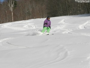 An image of Stephen cutting tracks through the powder on the Spell Binder trail at Bolton Valley Ski Resort in Vermont