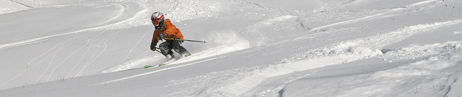 An image of Ty schussing the powder on the Spell Binger headwall at high speed at Bolton Valley Ski Resort in Vermont
