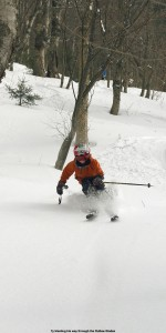 An image of Ty skiing powder in the Outlaw Glades at Bolton Valley Ski Resort in Vermont