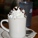 An image of Hot Chocolate topped with whipped cream at the James Moore Tavern at Bolton Valley Ski Resort in Vermont